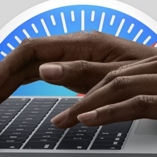 A safari logo and hands on a Mac keyboard