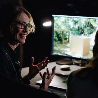 A film maker works on a Mac