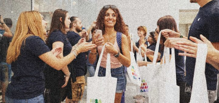 A girl carrying shopping leaves an Apple store in Milan