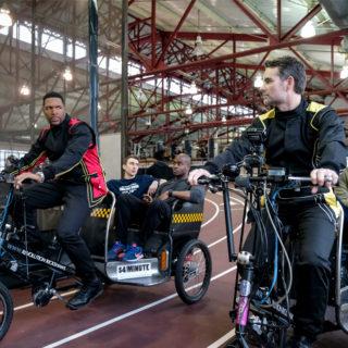 Michael Strahan and Jeff Gordon on rickshaws